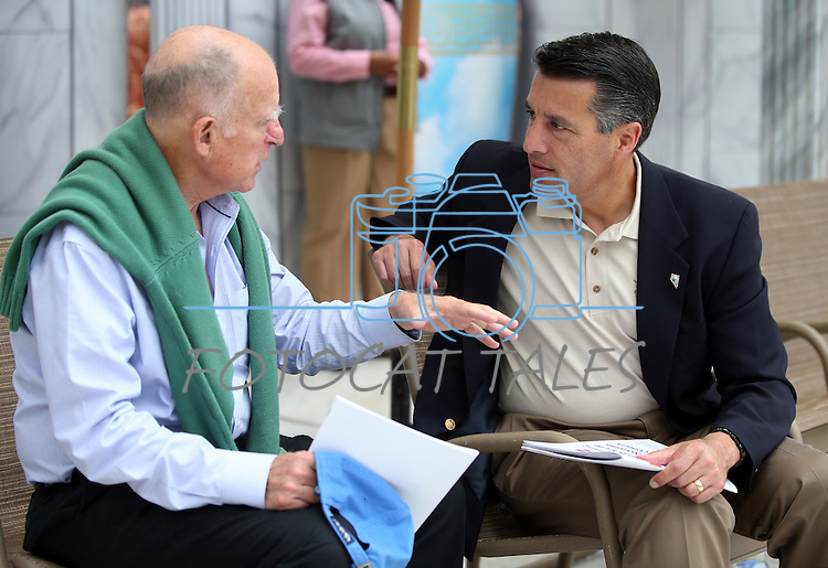 California Gov. Jerry Brown and Nevada Gov. Brian Sandoval talk following the 17th annual Lake Tahoe Summit conference at Sand Harbor, near Incline Village, Nev., on Monday, Aug. 19, 2013. <br /> Photo by Cathleen Allison