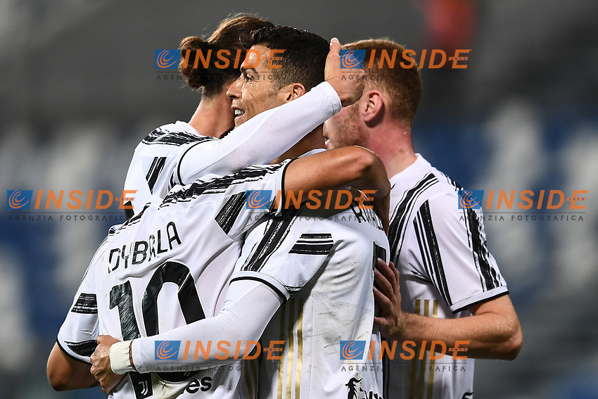 Cristiano Ronaldo of Juventus FC celebrates with team mates after scoring the goal of 0-2 during the Serie A football match between US Sassuolo and Juventus FC at Citta del Tricolore stadium in Reggio Emilia (Italy), May 2nd 2021. Photo Image Sport / Insidefoto