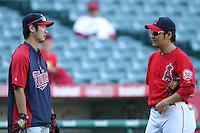 Minnesota Twins shortstop Tsuyoshi Nishioka #1 talks with Los Angeles Angels pitcher Hisanori Takahashi #21 before a game at Angel Stadium on September 2, 2011 in Anaheim,California. Minnesota defeated Los Angeles 13-5.(Larry Goren/Four Seam Images)