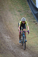 Emily Werner of the United State descends a steep hill Wednesday, Oct. 13, 2021, while competing in the Union Cycliste Internationale Cyclo-cross World Cup at Centennial Park in Fayetteville. The city was one of 16 sites around the globe to hold a world cup event this year for Union Cycliste Internationale, known as International Cycling Union in the United States. Fayetteville will host the UCI World Championships at Centennial Park Jan. 28-30. Visit nwaonline.com/211014Daily/ for today's photo gallery.<br /> (NWA Democrat-Gazette/Andy Shupe)