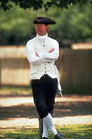 Man in period dress posing at Colonial Williamsburg. Williamsburg, Virginia.