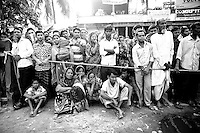 Anxious wait: Relatives of the missing garments workers of Rana plaza, waits outside of the collapsed building in Savar, near Dhaka, Bangladesh.