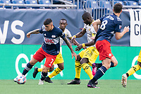 FOXBOROUGH, MA - MAY 16: Gustavo Bou #7 of New England Revolution prepares to drive the ball down to the midfield during a game between Columbus SC and New England Revolution at Gillette Stadium on May 16, 2021 in Foxborough, Massachusetts.