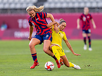 KASHIMA, JAPAN - AUGUST 5: Lindsey Horan #9 of the USWNT fights for the ball with Kyah Simon #17 of Australia during a game between Australia and USWNT at Kashima Soccer Stadium on August 5, 2021 in Kashima, Japan.