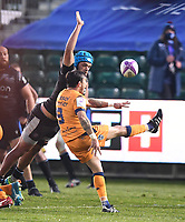 1st May 2021; Recreation Ground, Bath, Somerset, England; European Challenge Cup Rugby, Bath versus Montpellier; Benoit Paillaugue of Montpellier kicks from the base of the ruck under pressure from Zach Mercer of Bath