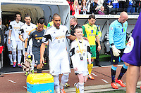 Swansea v Norwich, Liberty stadium Swansea, Saturday 29th March 2014<br /> <br /> Photographs by Amy Husband<br /> <br /> Swansea's Ashley Williams leading the team out.