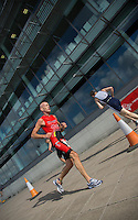 28 JUL 2013 - LONDON, GBR - Age group competitors turn by Building 1000 during the run at the 2013 Virgin Active London Triathlon at Royal Victoria Dock in London, Great Britain (PHOTO COPYRIGHT © 2013 NIGEL FARROW, ALL RIGHTS RESERVED)