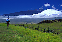 Hiking in North Kohala with Mauna Kea in rear, Big Island of Hawaii