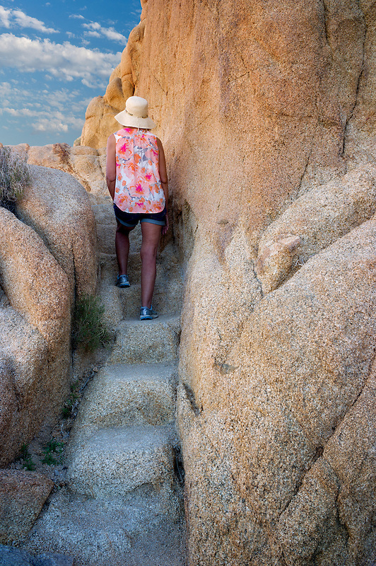 Pathway and steps carved in granite with hiker. Joshua Tree National Park, California