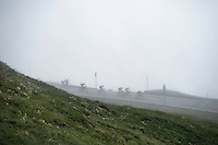 descending in the mist from the highest point in the 2016 Tour; the Port d'Envalira (Cat1/2408m/22.6km at 5.5%)<br /> <br /> stage 10: Escaldes-Engordany (AND) - Revel (FR)<br /> 103rd Tour de France 2016