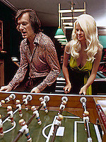 Hufh Hefner plays game with girlfriend Karen Christy at his Chicago mansion, 1973. Photo by John G. Zimmerman.