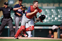 2GCL Twins catcher Austin Hale (70) tracks down a loose ball in front of home plate umpire Kenny Jackson during the first game of a doubleheader against the GCL Orioles on August 1, 2018 at CenturyLink Sports Complex Fields in Fort Myers, Florida.  GCL Twins defeated GCL Orioles 7-6 in the completion of a suspended game originally started on July 31st, 2018.  (Mike Janes/Four Seam Images)