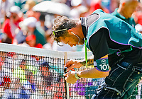 London, England, 2 th July, 2018, Tennis,  Wimbledon, <br /> technician mounting net sensor<br /> Photo: Henk Koster/tennisimages.com