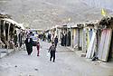 Irak 2000.La rue principale de Kasré avec les drapeaux du parti: le KDP.Iraq 2000.Kasrey's main street