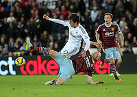Pictured: Nelson Oliveira, the new signing for Swansea is fouled by James Collins of West Ham Saturday 10 January 2015<br /> Re: Barclays Premier League, Swansea City FC v West Ham United at the Liberty Stadium, south Wales, UK