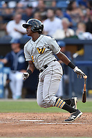 West Virginia Power third baseman Ke'Bryan Hayes (22) swings at a pitch during a game against the Asheville Tourists at McCormick Field on June 23, 2016 in , North Carolina. The Tourists defeated the Power 3-2. (Tony Farlow/Four Seam Images)