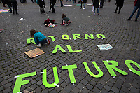 """Rome, Italy. 19th March, 2021. Today, Fridays for Future Rome (1.) - supported by various other Organizations and Movements - held a demonstration in Piazza del Popolo (2.) to mark the second anniversary of the Global Strike for Future demonstration (3.). The aim of the rally was to call the new Italian Government led by Professor Mario Draghi, and all the world Governments, to act for an immediate plan, investments and policies against the so called """"climate changes"""" and the consequent climate crisis. The """"Fridays for Future"""" actions are a series of global demonstrations directly related to Greta Thunberg (4.), the teenager """"Swedish political activist seeking to stop global warming and climate change, [who] in August 2018 became a prominent figure for starting the first school strike for climate, outside the Swedish parliament building"""" (source Wikipedia.org, 5.).<br /> <br /> Footnotes & Links:<br /> 1. https://facebook.com/FFFroma<br /> 2. https://www.facebook.com/events/519326452402327/<br /> 3. 15.03.2019 - Global Strike For Future - Rome 15M #FridaysForFuture: https://lucaneve.photoshelter.com/gallery/15-03-2019-Global-Strike-For-Future-Rome-15M-FridaysForFuture/G0000UfwNkLvv7gU/C0000GPpTqAGd2Gg<br /> 4. @GretaThunberg (Personal Twitter page - No Personal Website available) <br /> 5. https://en.wikipedia.org/wiki/Greta_Thunberg"""