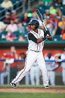 Lansing Lugnuts shortstop Richard Urena (1) at bat during a game against the Peoria Chiefs on June 6, 2015 at Cooley Law School Stadium in Lansing, Michigan.  Lansing defeated Peoria 6-2.  (Mike Janes/Four Seam Images)