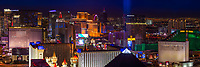 Amazing aerial panoramic view of the Las Vegas Strip illuminated at dusk, with the Luxor Excalibur and MGM casinos in the foreground, Las Vegas Nevada