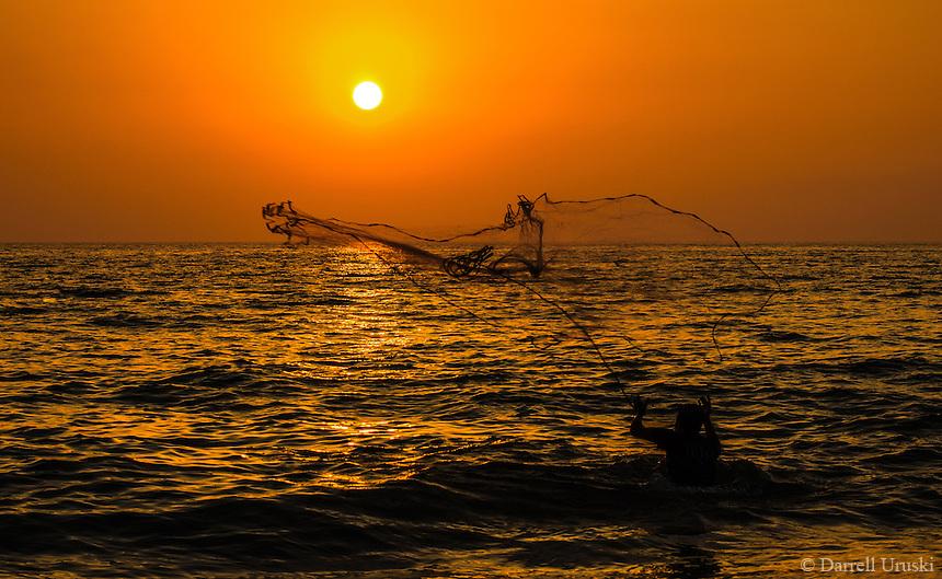 Fine Art Print, Photograph. Sunset scene of a net fishermen casting his net onto the ocean in Puerto Vallarta, Mexico.