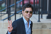 Actor John Stamos visits with fans outside the federal courthouse in Marquette, Michigan after the trial of two people charged with trying to extort money from him.