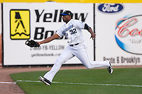 Left Fielder Carlos Sosa (32) of the Connecticut Defenders is fully extended to make a running catch at Dodd Stadium in Norwich, CT, Tuesday, June 3, 2008.