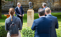 BNPS.co.uk (01202) 558833. <br /> Pic: CorinMesser/BNPS<br /> <br /> Pictured: Turing's nephew and fellow Sherborne School alumni, author Sir John Dermot Turing and, right, sculptor David Williams-Ellis unveil the bust. <br /> <br /> A magnificent bronze bust of Enigma codebreaker Alan Turing has today gone on display at his former school.<br /> <br /> The bust, which is just over life size, stands on a plinth at Sherborne School in Dorset, where the genius mathematician and father of computer science was a pupil from 1926 to 1931.<br /> <br /> It was unveiled by Turing's nephew and fellow Sherborne School alumni, author Sir John Dermot Turing.<br /> <br /> During the Second World War Turing worked for the Government Code and Cypher School (GC&CS) at Bletchley Park, Bucks, Britain's code-breaking centre. He played a pivotal role in cracking the German Enigma code that enabled the Allies to defeat the Nazis in many crucial battles.<br /> <br /> The bust has been fashioned by acclaimed sculptor David Williams-Ellis, who has previously commemorated the D-Day landings in sculpture for the Normandy Memorial Trust.