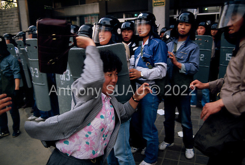 """Seoul, South Korea<br /> May 1, 1987<br /> <br /> The Korean middle-class began joining the students in their assault on the government and riot police.<br /> <br /> After two decades of building an economic miracle, in the summer of 1987 tens of thousands of frustrated South Korean students took to the streets demanding democratic reform. """"People Power"""" Korean-style saw Koreans from all social spectrums join in the protests.<br /> <br /> With the Olympics to be held in South Korea in 1988, President Chun Doo Hwan decided on no political reforms and to choose the ruling party chairman, Roh Tae Woo, as his heir. The protests multiplied and after 3 weeks Chun conceded releasing oppositionist Kim Dae Jung from his 55th house arrest and shaking hands with opposition leader Kim Young Sam. Days later he endorsed presidential elections and an amnesty for nearly 3,000 political prisoners. It marked the first genuine initiative of democratic reform in South Korea and the people had their victory."""