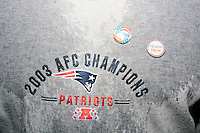 Ed Groves, of Hooksett, NH, wears vintage campaign buttons for Reagan and Nixon on a New England Patriots 2003 AFC Champions sweater before Texas senator and Republican presidential candidate Ted Cruz speaks at The Village Trestle restaurant in Goffstown, New Hampshire, on Wed., Feb. 3, 2016.