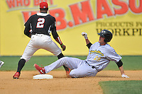 Brock Stassi (28) of the Reading Fightin Phils slides into second base in front of shortstop Tony Thomas (2) during a game against the New Britain Rock Cats at New Britain Stadium on July 13, 2014 in New Britain, Connecticut.  Reading defeated 6-4.  (Gregory Vasil/Four Seam Images)