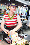 © Joel Goodman - 07973 332324 . 14/08/2015 . Hyde , UK . Staff picking an order for customers who use McDonalds' new order screen and waited table service at their branch in Mottram , Hyde . Photo credit : Joel Goodman