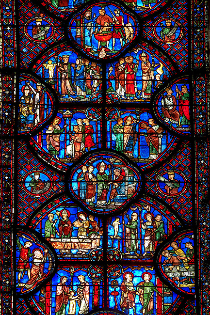 Medieval stained glass Window of the Gothic Cathedral of Chartres, France - dedicated to St Sylvester.  Bottom left - The young Sylvester presented by his mother to the priest Cyrinus, bottom right - Sylvester welcoming St Timothy to his house. Bottom side panels right - above right - Execution of St Timothy , side panel left - Death of the prefect Tarquin, who chokes on a fish bone. Two centre panels, left- Funeral of St Timothy, right - Sylvester refusing the prefect's orders to worship an idol. Top central oval panel - Sylvester released from prison by Pope Melchiades. Above left - People beg Sylvester (holding book) to become a deacon, above right - Sylvester is ordained by Melchiades as deacon. Top side panel , right - After the death of Melchiades Sylvester installed as Pope, left - Emperor Constantine falls ill (note doctor with urine flask). Top two panels - left -  Constantine orders sacrifices to an idol, right - Pope Sylvester and his followers flee persecution. Top central oval panel - Soldiers about to prepare a bath with the blood of 3000 children. A UNESCO World Heritage Site.