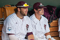 Mississippi State first baseman Wes Rea (35) and outfielder Hunter Renfro (34) talk in the dugout before Game 1 of the 2013 Men's College World Series Finals against the UCLA Bruins on June 24, 2013 at TD Ameritrade Park in Omaha, Nebraska. The Bruins defeated the Bulldogs 3-1, taking a 1-0 lead in the best of 3 series. (Andrew Woolley/Four Seam Images)