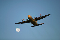 C-130 Hercules from UN World Food Program WFP takes off from a base in kenya to drop food in Southern Sudan.