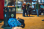 """© Joel Goodman - 07973 332324 . 15/12/2017. Manchester, UK. A man and a woman help a companion in to a taxicab . Revellers out in Manchester City Centre overnight during """" Mad Friday """" , named for historically being one of the busiest nights of the year for the emergency services in the UK . Photo credit : Joel Goodman"""
