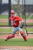 Washington Nationals catcher Matt Reistetter (51) throws to first base during a minor league Spring Training game against the Houston Astros on March 28, 2017 at the FITTEAM Ballpark of the Palm Beaches in West Palm Beach, Florida.  (Mike Janes/Four Seam Images)