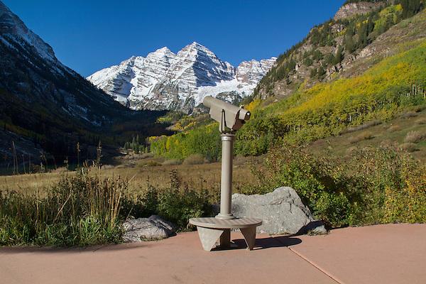 Telescope pointed to the Maroon Bells in autumn, Aspen, Colorado, John offers autumn photo tours throughout Colorado. John offers fall foliage photo tours throughout Colorado.