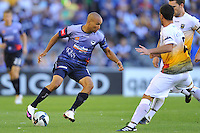 MELBOURNE, AUSTRALIA - JANUARY 26, 2010: Archie Thompson from Melbourne Victory traps the ball in round 19 of the A-league match between Melbourne Victory and Wellington Phoenix FC at Etihad Stadium on January 26, 2010 in Melbourne, Australia. Photo Sydney Low www.syd-low.com