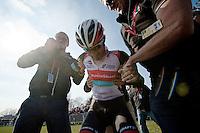 111th Paris-Roubaix 2013..winner: Fabian Cancellara (CHE) assisted getting up by RSLT press officer Tim Vanderjeugd & DS Dirk Demol..