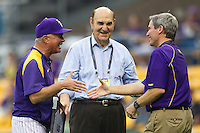 LSU Tigers coach Paul Mainieri, former athletic director Skip Bertman honor public address announcer Bill Franques before the game against the Auburn Tigers on March 23, 2013 at Alex Box Stadium in Baton Rouge, Louisiana. LSU defeated Auburn 5-1. (Andrew Woolley/Four Seam Images).