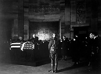 President Harding placing wreath of flowers on casket of Unknown Soldier in rotunda of the Capitol.  November 9, 1921. (Army)<br />NARA FILE #:  111-SC-74402<br />WAR & CONFLICT BOOK #:  708
