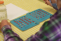 A player's boards fill with letters and number on Tuesday Sept. 7 2021 during bingo games at the Billy V. Hall Senior Activity and Wellness Center in Gravette.<br />(NWA Democrat-Gazette/Flip Putthoff)