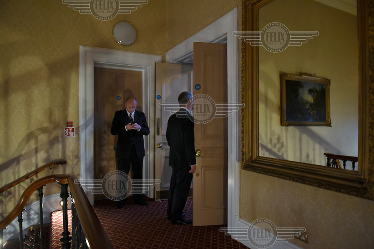 Nigel Farage leans, momentarily, on a door frame, as he waits to go on stage and give a public speech at the Rochester Corn Exhange in Rochester, Kent during campaigning for the 7 May 2015 general election where he sought to become MP for South Thanet.