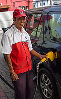 Gas Station Attendant Pumping Gas, Ipoh, Malaysia.