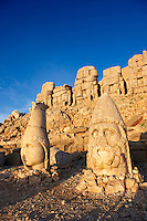 Image of the statues of around the tomb of Commagene King Antochus 1 on the top of Mount Nemrut, Turkey. Stock photos & Photo art prints. In 62 BC, King Antiochus I Theos of Commagene built on the mountain top a tomb-sanctuary flanked by huge statues (8–9 m/26–30 ft high) of himself, two lions, two eagles and various Greek, Armenian, and Iranian gods. The photos show the broken statues on the  2,134 m (7,001 ft)  mountain. 4