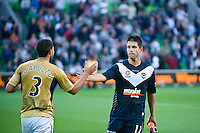 MELBOURNE, AUSTRALIA - DECEMBER 27: Rodrigo Vargas of the Victory and Adam D'Apuzzo of the Jets shake hands after the round 20 A-League match between the Melbourne Victory and the Newcastle Jets at AAMI Park on December 27, 2010 in Melbourne, Australia. (Photo by Sydney Low / Asterisk Images)