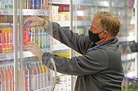 Mike Duyne stocking shelves.