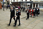 """Hercules Clay Penny Loaf Day. The procession from the Town Hall to St Mary Magdalene Church, the sea cadet carries a replica of Herclules Clay's bible.<br /> <br /> Hercules Clay Penny Loaf Day. Hercules Clay a wealthy cloth merchant who was a former Newark businessman and in 1644 Royalist Mayor of the town during the English Civil War. For three nights in a row he dreampt of his house burning and he took this as an omen, moving out just before the house was indeed damaged by a """"grenado"""", a mortar shell fired by the besieging Parliamentary forces.  He died in 1645, and in his Will he left a legacy providing for an annual sermon in which the preacher was to 'exhort the people not to set their affections on things of this world but by their good works to lay … hold on eternal life', and for bread to be distributed to the poor."""