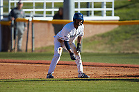 Justin Guy (1) of the Wingate Bulldogs takes his lead off of first base against the Concord Mountain Lions at Ron Christopher Stadium on February 2, 2020 in Wingate, North Carolina. The Mountain Lions defeated the Bulldogs 12-11. (Brian Westerholt/Four Seam Images)