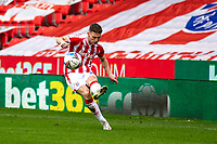 20th March 2021; Bet365 Stadium, Stoke, Staffordshire, England; English Football League Championship Football, Stoke City versus Derby County; Jordan Thompson of Stoke City passes the ball